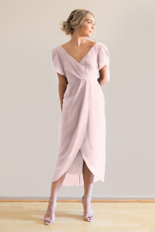 Zara in light pink bridesmaids dress