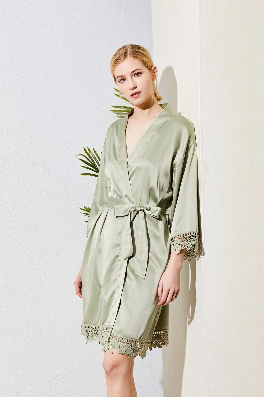 Sage green bridesmaid robes with lace